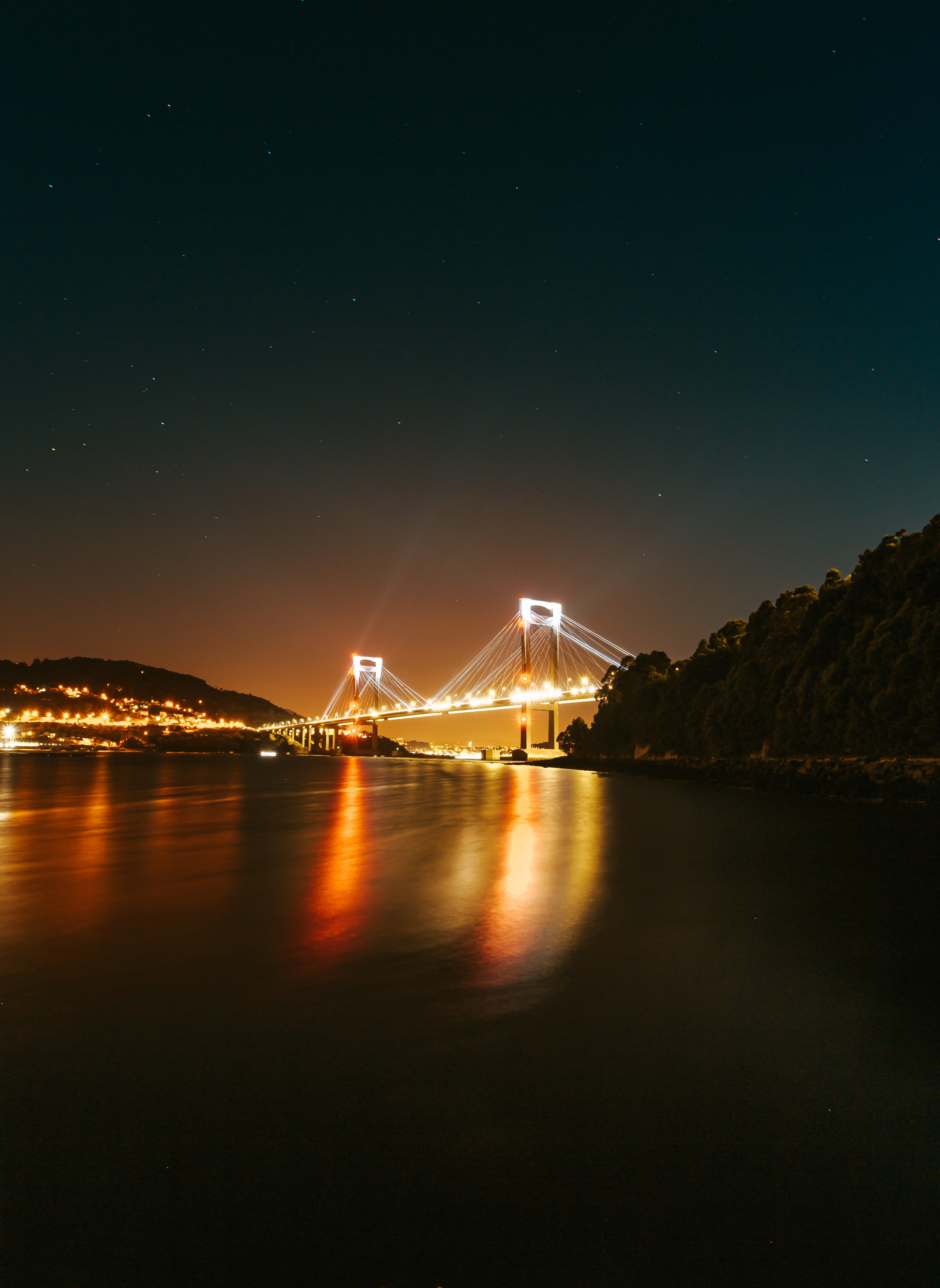 145465 download wallpaper Nature, Bridge, Glow, Sea, Night, Lights screensavers and pictures for free