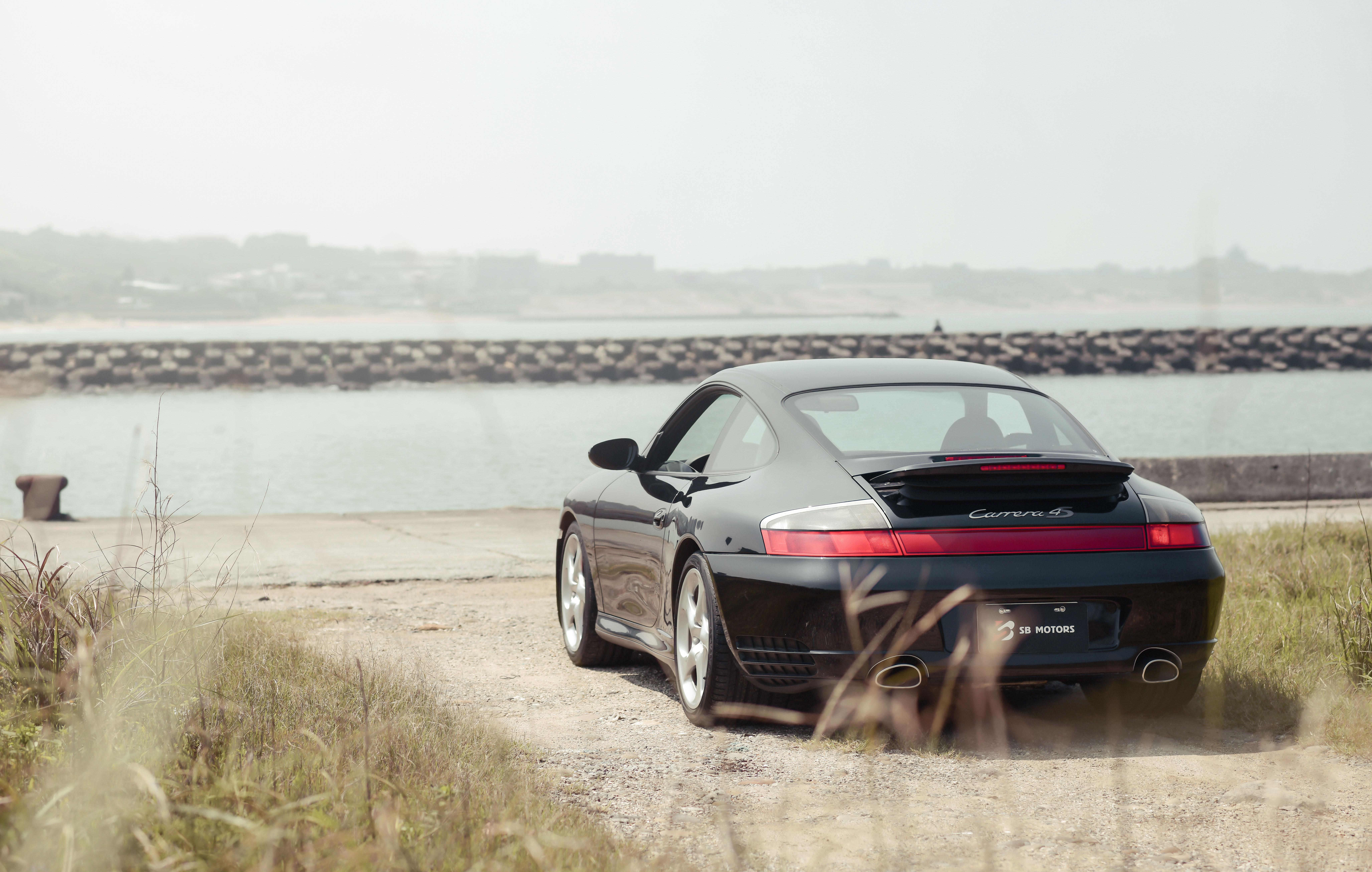 77921 Заставки и Обои Порш (Porsche) на телефон. Скачать Порш (Porsche), Тачки (Cars), Черный, Машина, Спорткар, Вид Сзади, Набережная, Porsche 911 Carrera 4S картинки бесплатно